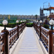 Beautiful bridge with wooden railings and lamps — Stock Photo