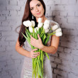 Stock Photo: Beauty Woman with Spring Flower bouquet. Beautiful girl with a B