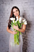 Beauty Woman with Spring Flower bouquet. Beautiful girl with a B — Stock Photo