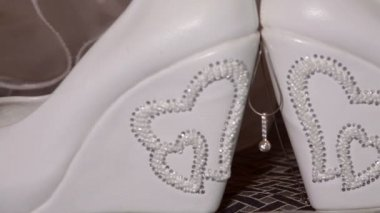 Beautiful white bridal shoes and accessories — Stock Video