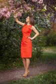 Beautiful girl in spring garden — Stock Photo