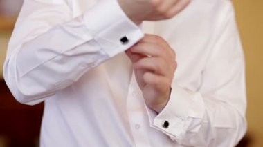Man wears white shirt and cufflinks — Stock Video