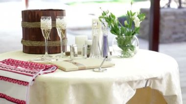Table with wedding accessories and two glasses of champagne — Stock Video