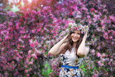 Beautiful girl outdoors spring portrait, young woman with flowers in green park, spring concept. cheerful teenager walking outdoor. series in portfolio — Stock Photo