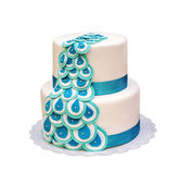 Beautiful two-tiered cake with turquoise ribbons. isolated — Stock Photo
