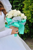 Bride Holding Bouquet of White Roses — Stock Photo