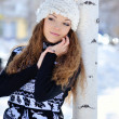 Young brunette girl in stripe sweater and white snow boots posin — Stock Photo #49641757