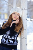 Young brunette girl in stripe sweater and white snow boots posin — Stock Photo