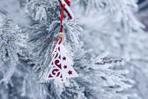Christmas background with snow-covered Christmas tree and Christmas toy — Stock Photo