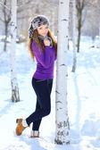 Beautiful girl in winter park — Stock Photo