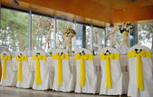 Decorated chairs on a celebratory banquet in yellow — Стоковое фото
