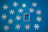 Christmas card with frame and snowflakes on a blue background — Стоковое фото