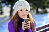 Winter woman with hot coffee  — Stock Photo