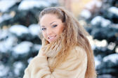 Laughing beautiful girl portrait in winter time with snow.  — Stock Photo