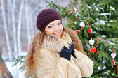 Beautiful winter woman playing with snow — Stock Photo