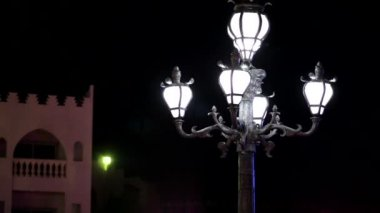 Street lampposts at night time — Stock Video