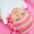 Charming child. Little girl in white knitted bear hat — Stock Photo #51654549