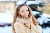 Woman is walking in park alley in winter  — Stockfoto