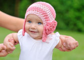 Beautiful baby girl with hat smiling — Stock Photo