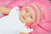 A baby in a pink knitted hat — Stock Photo