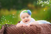 Baby on the grass in the park — Stock Photo