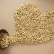 Paddy in heart shape on brown background — Stock Photo
