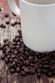 Cup of coffee. View from above on a wooden surface. — Stock Photo