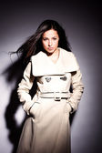 Woman in white modern coat — Stock Photo
