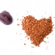 Instant coffee in the form of heart and a chocolate on a white b — Stock Photo #10916275