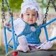 A baby on the swing — Stock Photo