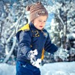 A liitle boy playing in a snowdrift — Stock Photo