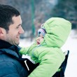 Winter portrait of father and his daughter — Stock Photo #15532375