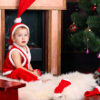 A baby in the Santa Claus — Stock Photo