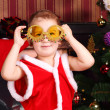 A boy with decorated glasses in the New Year — Stock Photo