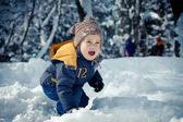 A little boy in a snowdrift — Stock Photo