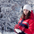 A girl modeling a snowball — Stock Photo