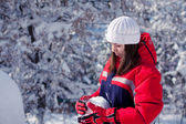 A girl with snowball — Stock Photo