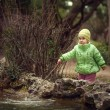 A little girl by the lake — Stock Photo