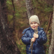 A boy by a tree with willow — Stock Photo