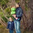 Father and two children in park in spring — Stock Photo #23063078