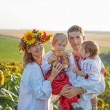 Stock Photo: Family Portrait in Ukrainian shirts in sunflowers
