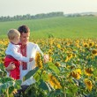 A father and young son in Ukrainian sunflower shirts considering — Stock Photo
