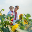 Stock Photo: Father and two children in Ukrainicostume at sunset in fi