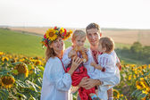 Family Portrait in Ukrainian shirts in sunflowers — Stock Photo