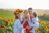 Family Portrait in Ukrainian shirts in sunflowers — Stock Photo