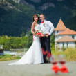 Bride and groom on the background of mountains — Stock Photo