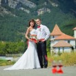 Royalty-Free Stock Photo: Bride and groom on the background of mountains