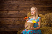 A surprised girl in the hayloft — Stock Photo