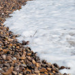 Vibrant waves crash on rocky shoreline — Foto Stock