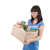 Young manager holding a box of personal items — Stock Photo